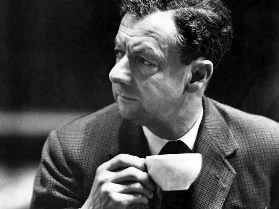 Benjamin Britten takes a cup of tea during rehearsals for his War Requiem at Coventry Cathedral, in Coventry, England in May, 1962.
