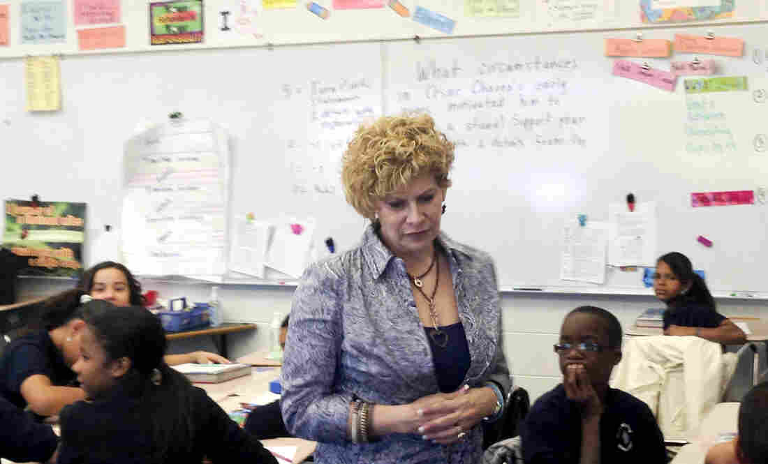 "Julia de Burgos Elementary teacher Gail Kantor, shown here in her sixth-grade class, says she buys things like clothing, books and school supplies for her students with her own money. ""Some kids don't ever have a dime,"" she says."