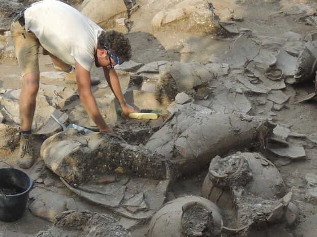 Graduate student Zach Dunseth carefully excavates wine jugs found in the ruins of a Canaanite palace that dates back to about 1700 B.C.