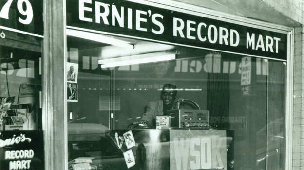 Morgan Babb — lead singer of the gospel group, the Radio Four — is pictured DJing in the window of Ernie's Record Shop circa 1955. The store was owned by Nashboro Records.