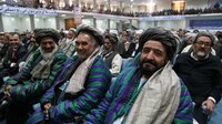 Afghan delegates to the Loya Jirga, or grand assembly, listen to Afghan President Hamid Karzai on Thursday. Some 2,500 elders and community leaders have gathered in Kabul to discuss a U.S.-Afghan security agreement that would define the role of U.S. troops after the combat mission ends next year.