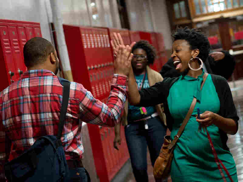 Terrell greets students in the hallway.