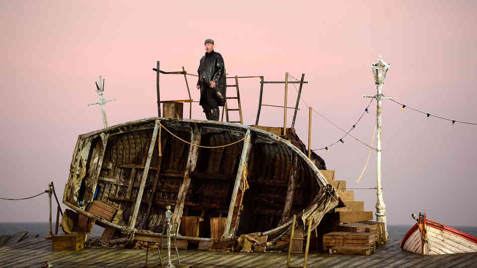 "A singer takes the stage during the first performance of ""Grimes on the Beach,"" an outdoor production of Benjamin Britten's opera Peter Grimes, on June 17, 2013 in Aldeburgh, England."