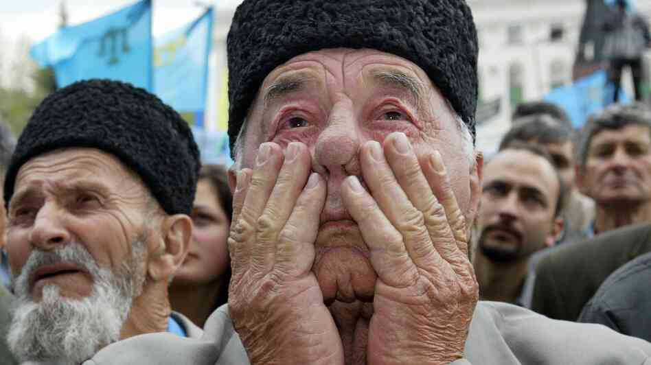 A Crimean Tatar man cries at a mass rally held in Simfropol, Ukraine, on May 18, 2004, the 60th anniversary of the deportation of Tatars from Crimea.