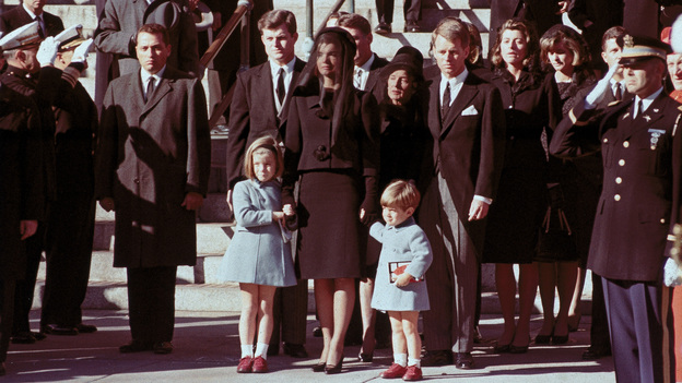 The first family watches John F. Kennedy's funeral procession in Washington, D.C., three days after the president was assassinated in Dallas. (AP)