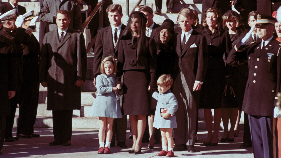 The first family watches John F. Kennedy's funeral procession in Washington, D.C., three days after the president was assassinated in Dallas.