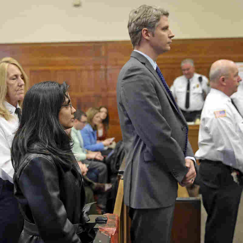 Former state chemist Annie Dookhan, left, stands alongside her attorney on Friday. She admitted faking test results in criminal cases and was sentenced to 3-to-5 years in prison.