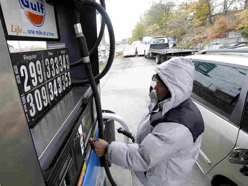 Gas prices are down compared with last year, but slumping consumer confidence could dampen Thanksgiving holiday travel.
