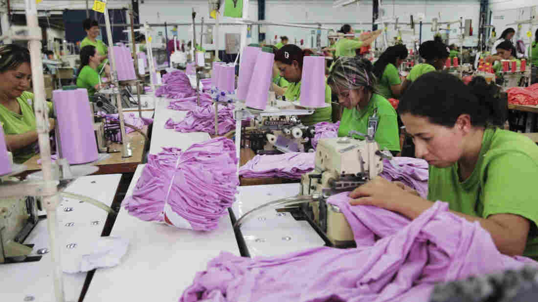 Lina Maria Tascón, Doris Restrepo, Noreli Morales and their co-workers sew Planet Money women's T-shirts.