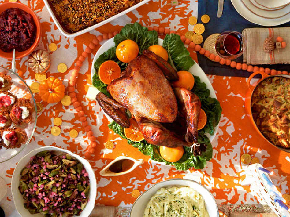 Manischewitz-brined turkey centers the Thanksgivukkah feast, surrounded by challah-apple stuffing, sweet potato bourbon noodle kugel, horseradish-spiked mashed potatoes, brussels sprouts with pastrami and pickled onions, and latke
