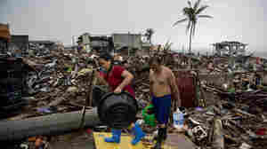 Friday in Tacloban, the Philippines, survivors continued to sift through the rubble.