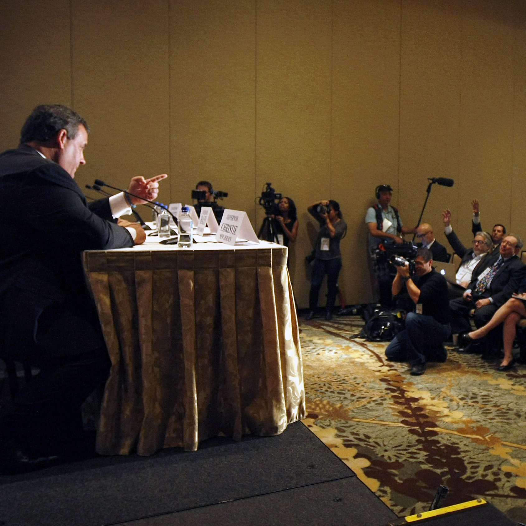 New Jersey Gov. Chris Christie takes questions during a news briefing at the Republican Governors Association conference on Thursday.