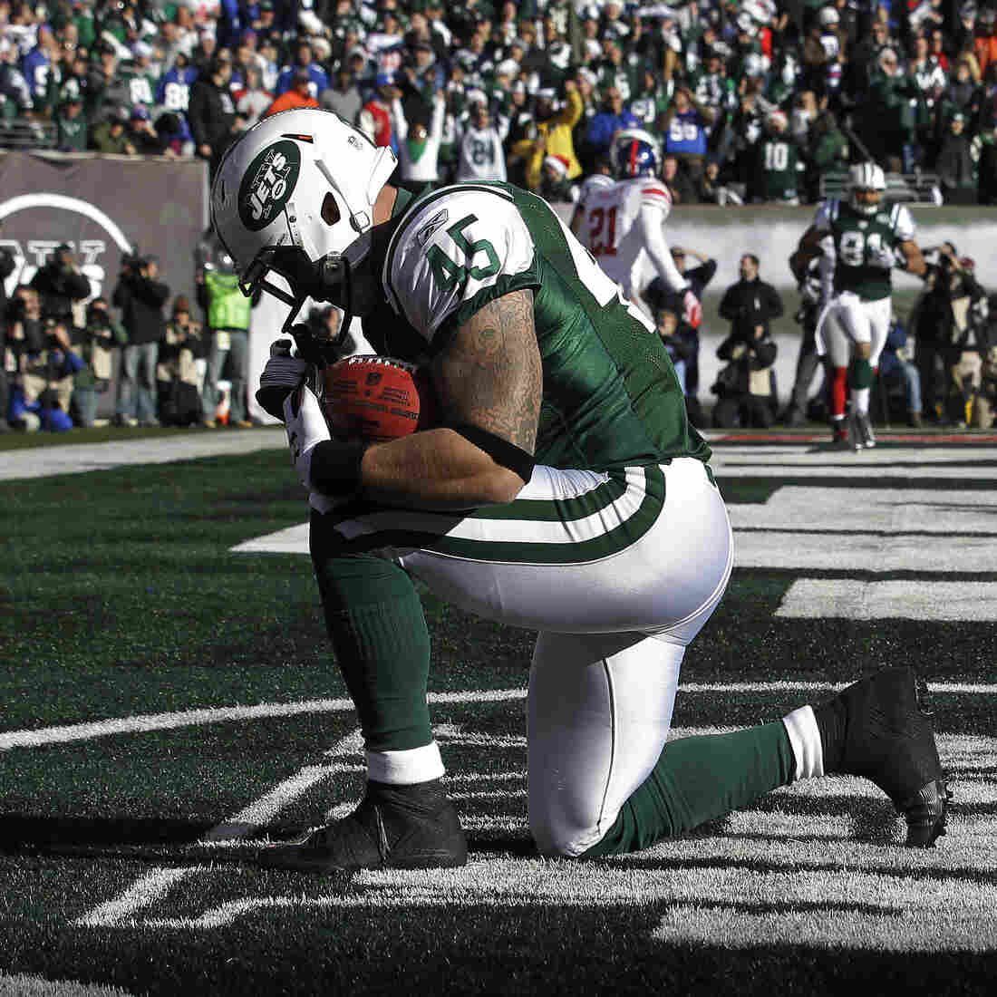 New York Jets tight end Josh Baker celebrates after scoring a touchdown during the first quarter in the game against the New York Giants in 2011.