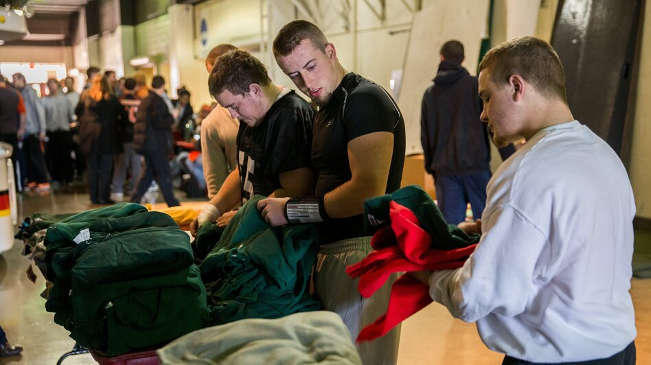 Washington players from left, Nick Sievers, Colton Marshall, and Brogan Brownfield receive donated workout clothes during a break from practice in Normal, Ill., on Tuesday. (MCT /Landov)