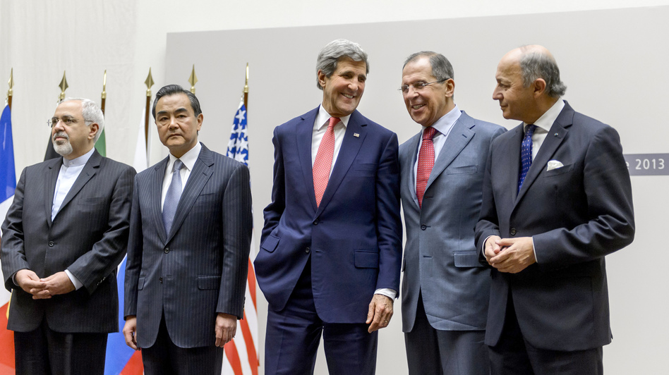 Iranian Foreign Minister Mohammad Javad Zarif, Chinese Foreign Minister Wang Yi, U.S. Secretary of State John Kerry, Russian Foreign Minister Sergei Lavrov and French Foreign Minister Laurent Fabius react during a statement early Sunday in Geneva.