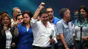 The National Party's Juan Orlando Hernandez in Tegucigalpa, Honduras, on Sunday. With a little less than half the ballots counted, Hernandez had 34 percent of the vote and was leading, but his main rival is also claiming victory.