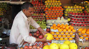New Delhi's colorful street markets are still the most economical places to shop. But prices for staples such as the lowly onion have soared in the past year.