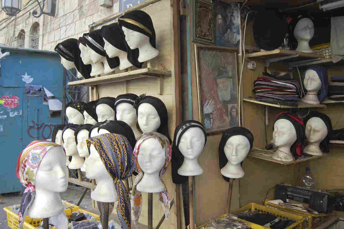 Headscarves in the $10-20 range worn by religious Jewish women are for sale in the ultra-orthodox Jerusalem neighborhood of Mea Shearim.