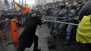 Opposition protesters clash with riot police in front of the Ukrainian Cabinet of Ministers in Kiev, Ukraine, on Monday.