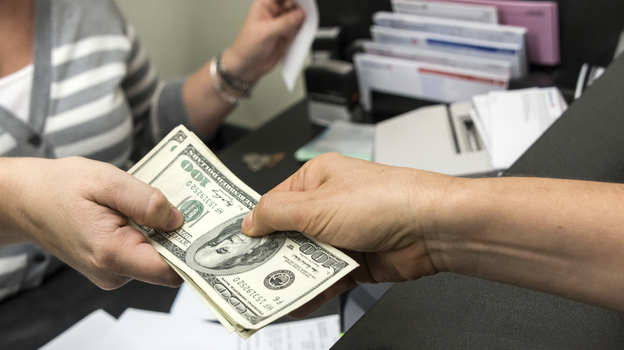 Federal regulators are setting new rules for banks that offer deposit advances. (iStockphoto)