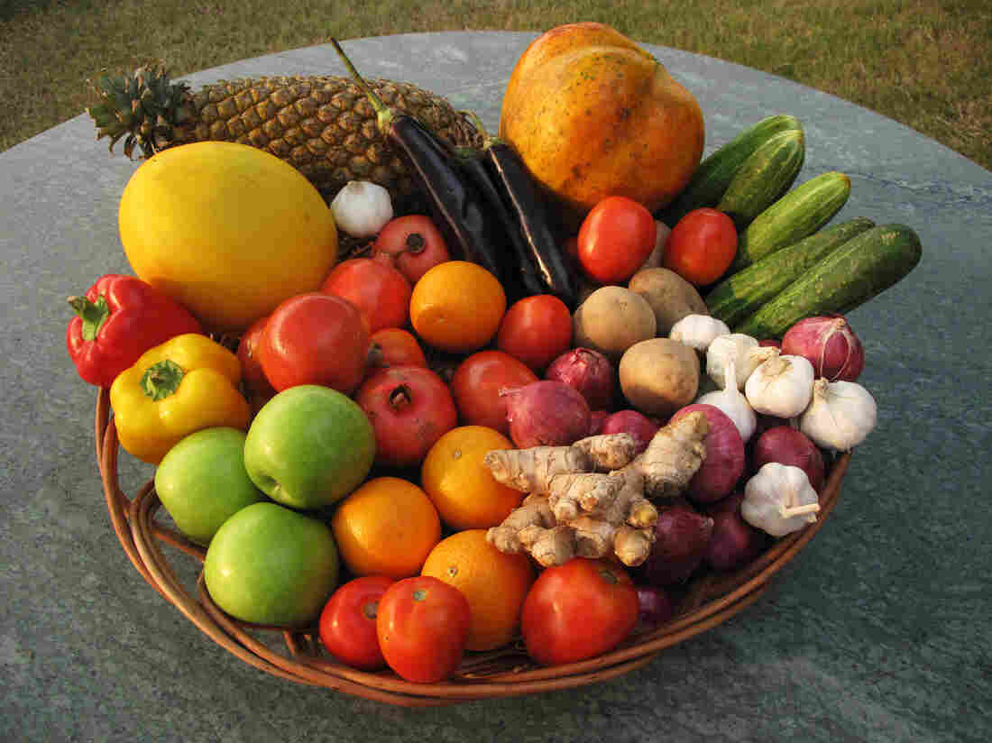We picked up several days' supply of vegetables and fruit: tomatoes, potatoes, coriander, pomegranates, oranges, onions, garlic, ginger, eggplant, cucumbers, peppers, apples, melon, pineapple and a basket to put them in.