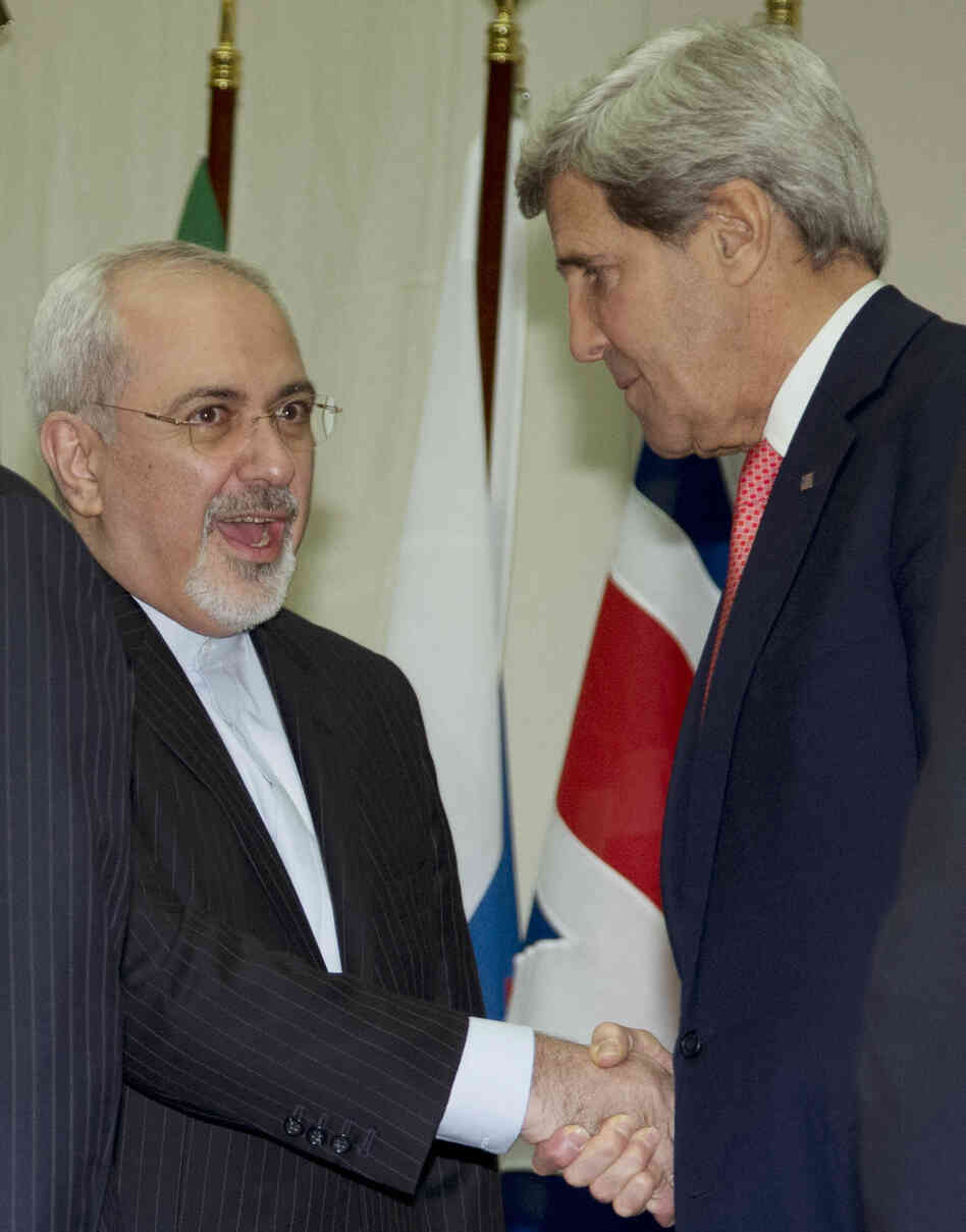 Secretary of State John Kerry and Iranian Foreign Minister Mohammad Javad Zarif shake hands Sunday at the United Nations Palais in Geneva, Switzerland.