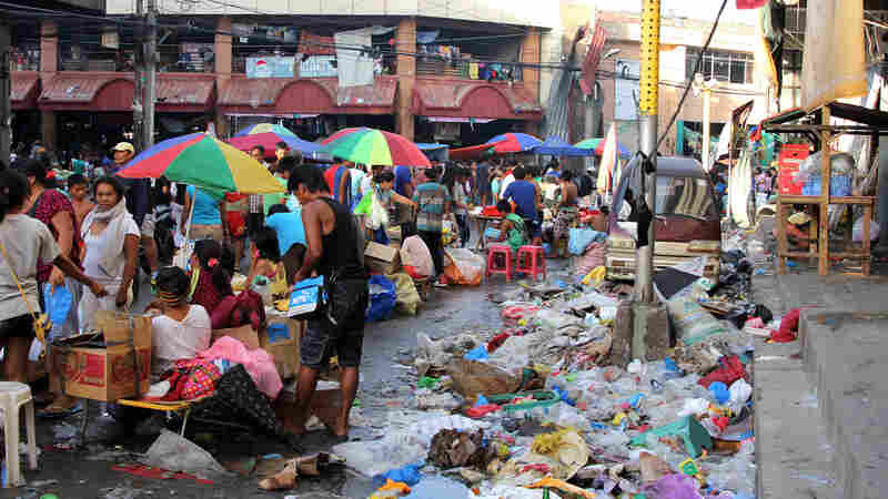 After The Storm: Commerce Returns To Damaged Philippines City