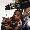 Dee Faught tests a robotic arm installed on his wheelchair in September. Commercially produced robotic arms can cost tens of thousands of dollars, but three Rice engineering students built one for Dee for about $800.