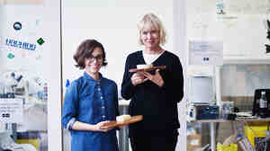 Microbiologist Christina Agapakis (left) and artist Sissel Tolass show off the cheese they made with bacteria from human skin. The project was part of Agapakis' graduate thesis at Harvard Medical School.