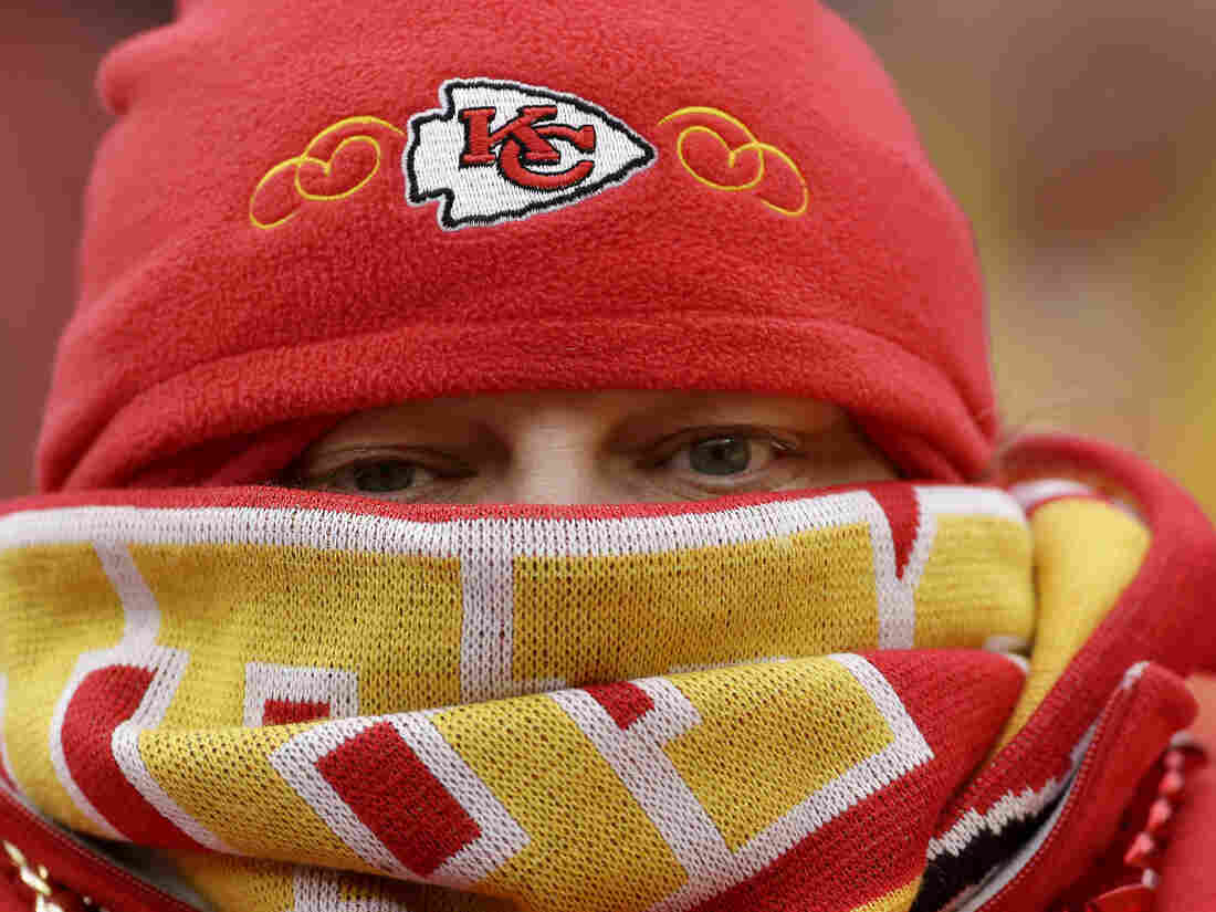 Brrr. This Chiefs fan was bundled up Sunday in Kansas City. Cold, stormy weather is spreading across much of the nation.
