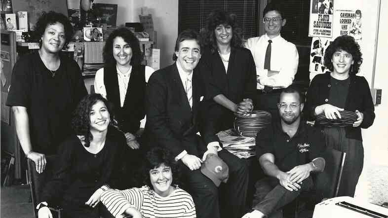 Weekend Edition Saturday staffers, photographed at NPR's former M Street headquarters, in Washington, D.C. Top left: (the late) Marta Haywood, Cindy Carpien, Scott Simon, Laura Ziegler, Steve Tripoli. Bottom left: Mandalit del Barco, Liz Buechel, Doug Mitchell, Neva Grant