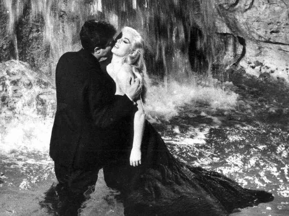 In director Federico Fellini's 1960 film La Dolce Vita, another journalist (Marcello Mastroianni) avails himself of the beauty of Rome, including Sylvia (Anita Ekberg) and the city's famous Fontana di Trevi.