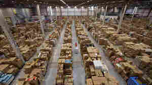 A worker at the Amazon fulfillment center in Swansea, Wales, processes orders in 2011.
