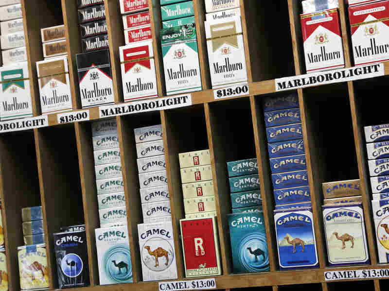 Cigarette packs are displayed at a convenience store in New York City, which has raised the age to buy cigarettes from 18 to 21.
