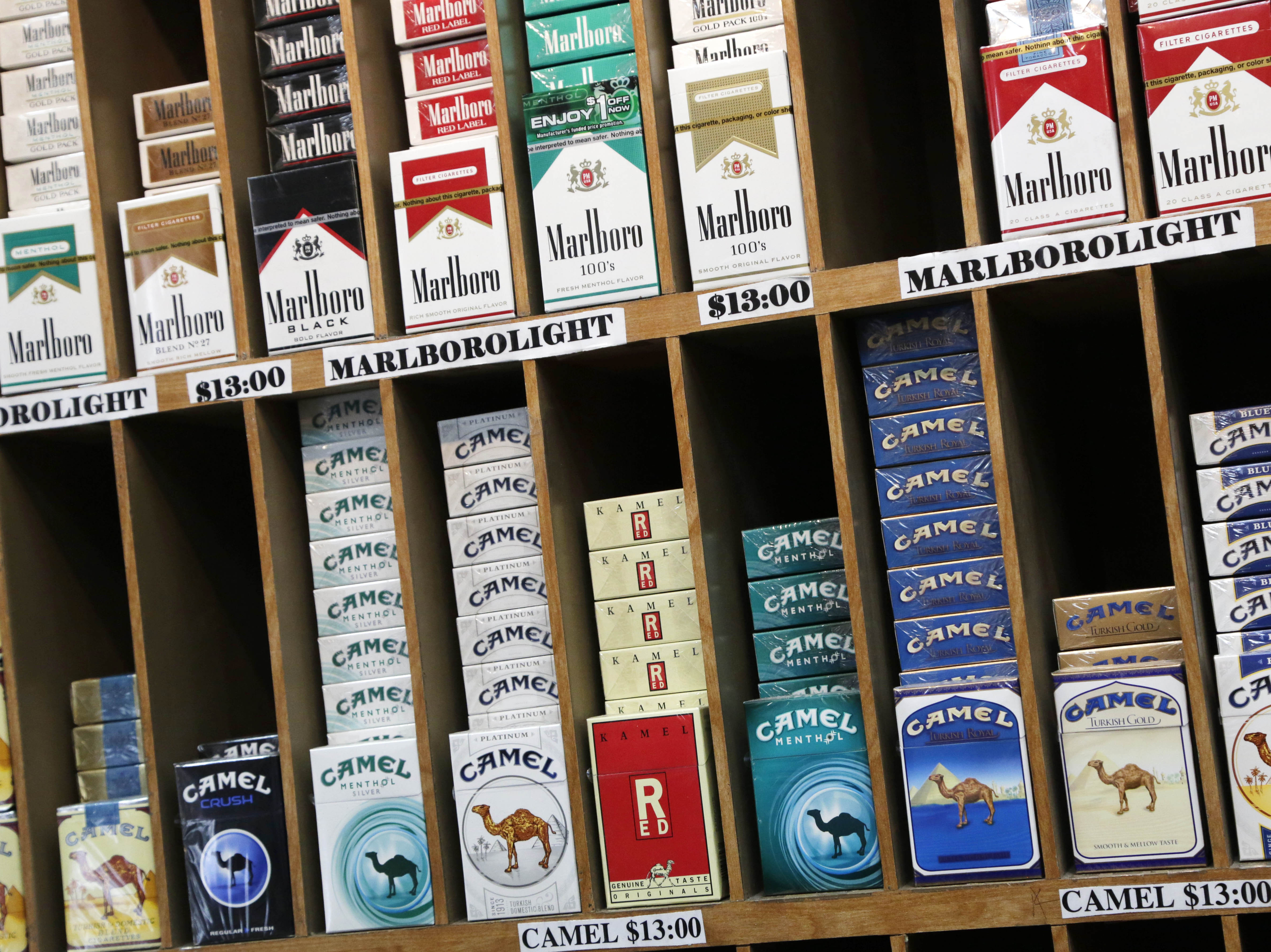Is Buying Cigarettes Online Legal - Cigarette packs are displayed at a convenience store in new york city which has raised the age to buy cigarettes from 18 to 21