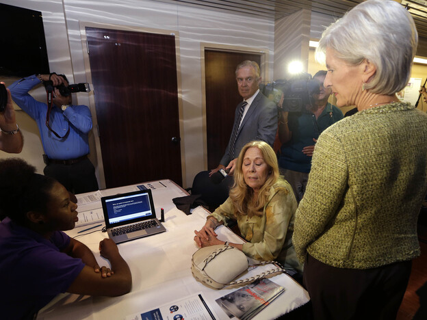 Health and Human Services Secretary Kathleen Sebelius visits navigators helping enroll people on HealthCare.gov.
