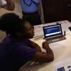 Health and Human Services Secretary Kathleen Sebelius visits navigators helping enroll people on HealthCare.gov.