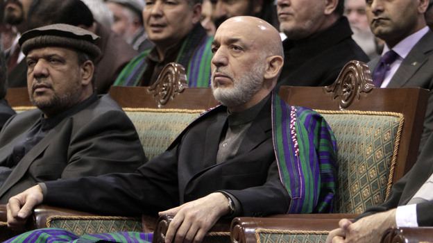Afghan President Hamid Karzai attends the Loya Jirga, or grand assembly, in Kabul on Sunday. The assembly approved a deal that would allow the U.S. to keep troops in Afghanistan beyond 2014. But Karzai has not yet agreed to sign the deal. (AP)