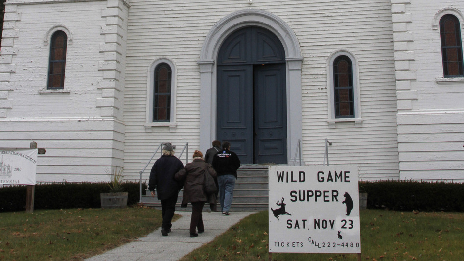 "Diners head into the Bradford United Church of Christ before the start of this year's Wild Game Supper. Food writer Calvin Trillin has dubbed the event ""the Superbowl of church suppers."""