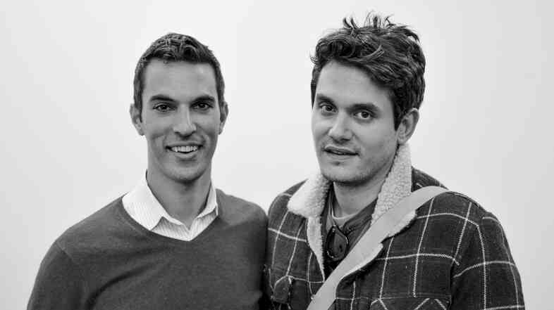 NPR Correspondent Ari Shapiro and John Mayer get chummy outside of the green room at the NPR Headquarters.