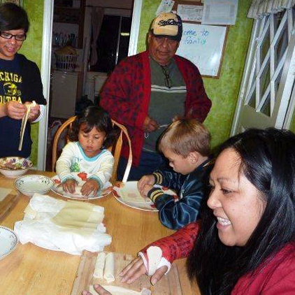 Melanie Vanderlipe Ramil is teaching the young people in her family how to make the traditional dish lumpia. Here, the family in 2009.