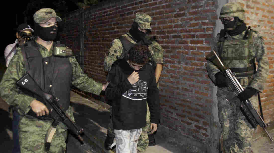 """A 2010 file photo shows Edgar """"El Ponchis"""" Jimenez Lugo in the city of Cuernavaca, Mexico. The teenage U.S. citizen who acknowledged being a drug-cartel killer has finished his three year juvenile-offender term for homicide, kidnapping and drug and weapons possession."""