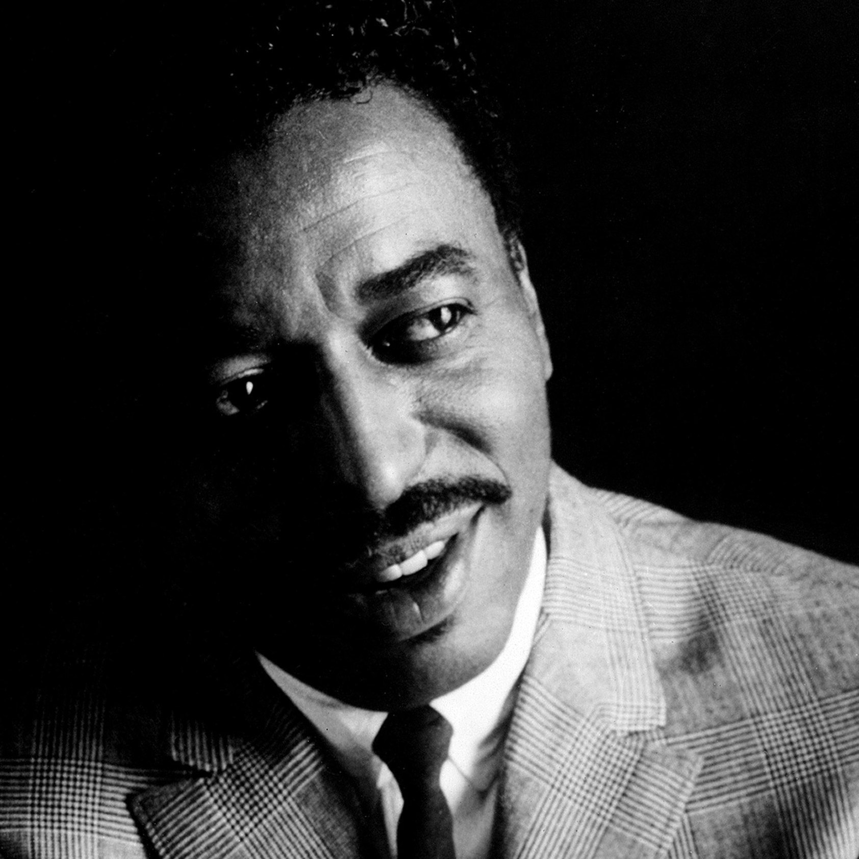 Chico Hamilton poses for a portrait c. 1958 in Los Angeles, Calif.