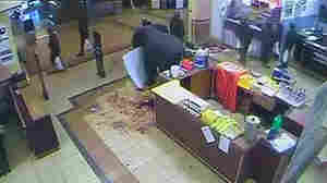 Video footage shows what appears to be Kenyan soldiers carrying plastic shopping bags as they leave a supermarket at Westgate Mall during a terrorist attack in Nairobi on Sept. 21. Kenya's security forces have long been rated as among the most corrupt institutions in the country, but even jaded Kenyans were shocked by the CCTV footage.