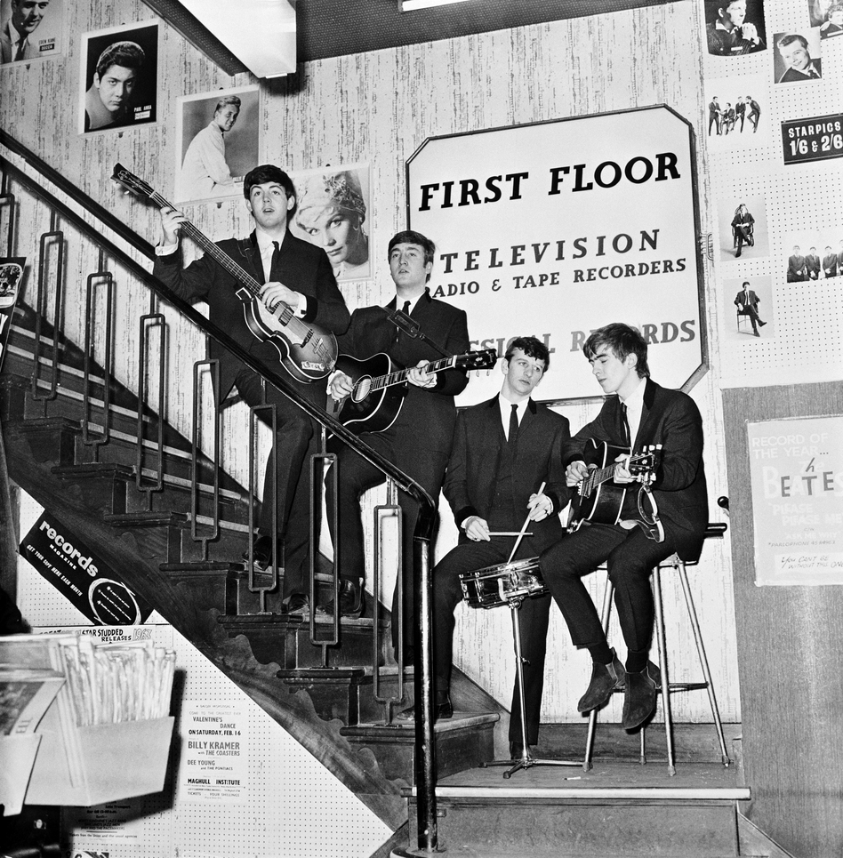 The Beatles on the stairs of NEMS — North End Music Stores,  Brian Epstein's Liverpool record shop — having just signed a management deal, in 1964. (Getty Images)