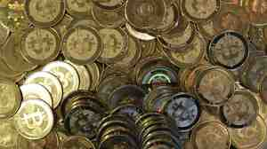 A Welsh man has realized that he threw out a stash of Bitcoins along with an old computer hard drive. At an exchange rate hit today, they would be worth around $7.5 million. Here, a photo of tokens representing Bitcoins.