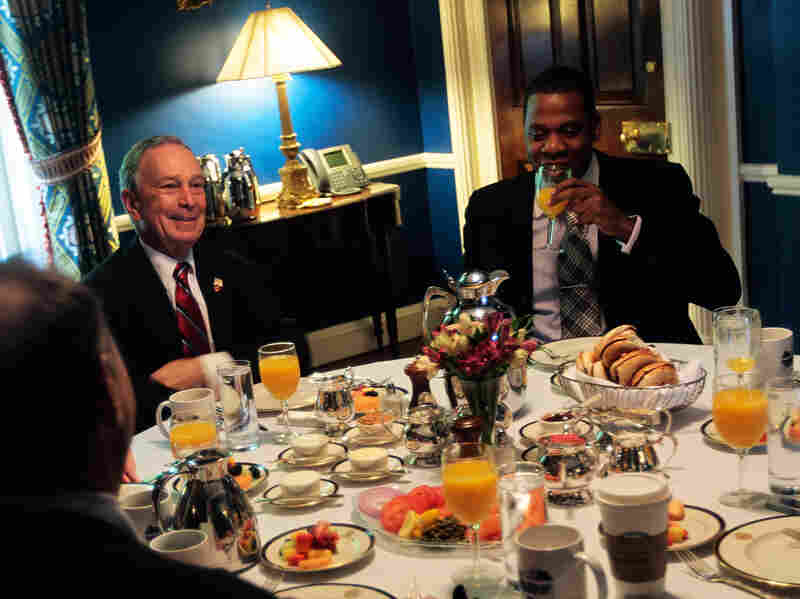 "Former New York City Mayor Michael Bloomberg and Shawn ""Jay-Z"" Carter sit with others at a breakfast meeting."