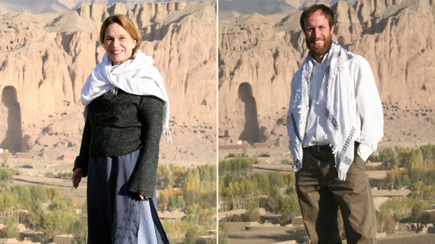 Renee Montagne and Jim Wildman in Bamiyan, Afghanistan, in photos they took of each other. In the background is the space where the giant Buddhas were located before the Taliban blasted them out. (Courtesy of Jim Wildman/NPR)