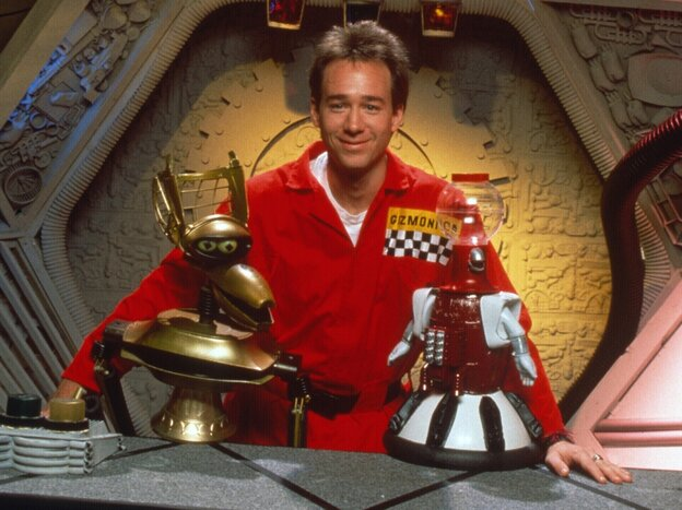 """Joel Hodgson poses with Crow T. Robot and Tom Servo, two of his """"robot friends."""""""