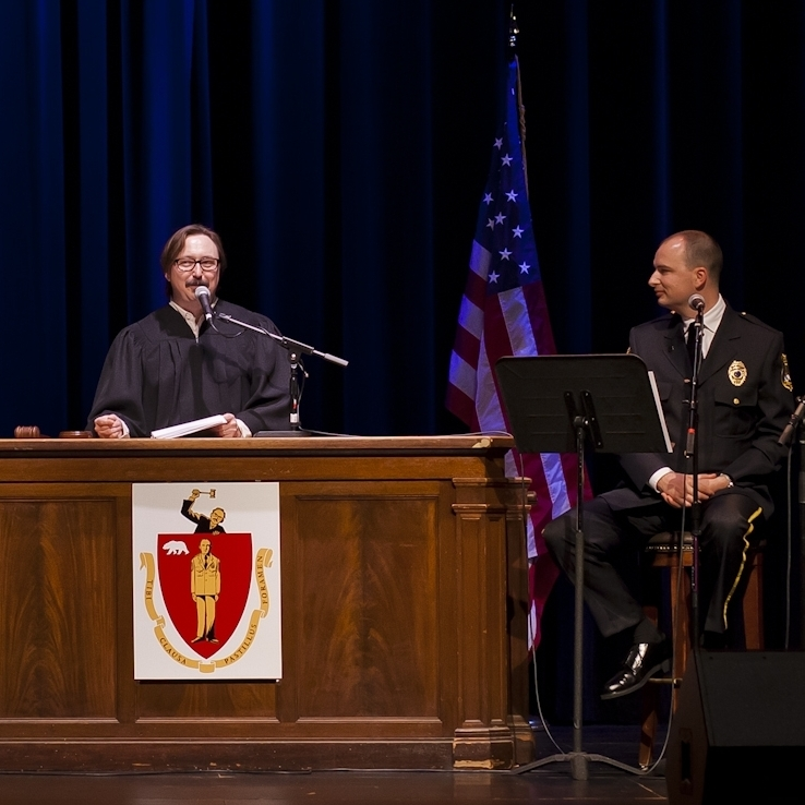 John Hodgman, left, presides over a live taping of the Judge John Hodgman podcast, as Jesse Thorn looks on.
